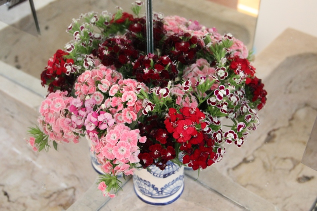 Dianthus arrangement in mirror