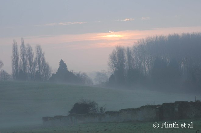 The pearly winter sunrise over the Cotswolds countryside