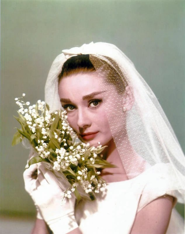 Audrey Hepburn with a bouquet of lily of the valley - two icons of elegance, one gamine actress and a dainty woodland flower