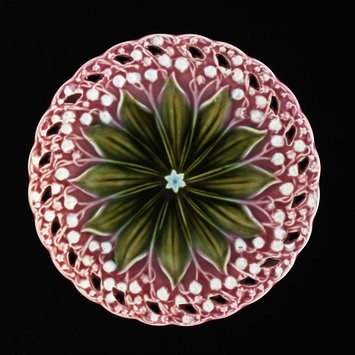 Villeroy & Boch earthenware plate with a spiral of lily of valley  (Photo Credit: Victoria &  Albert Museum)