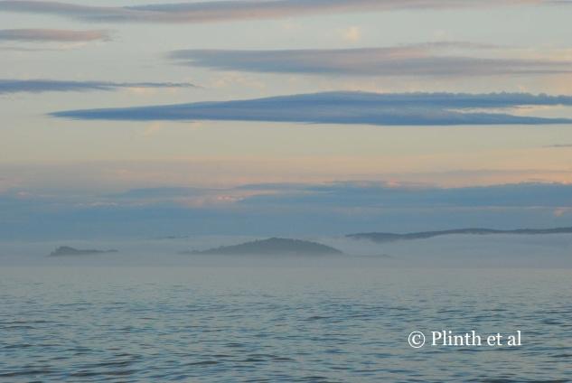 Morning fog over the Adventure Bay, Tasmania, Australia