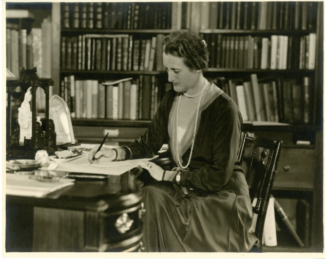 Beatrix Farrand writing at her desk in the reef Point Library, Maine (image courtesy of UC Berkeley Environmental Design Archives)