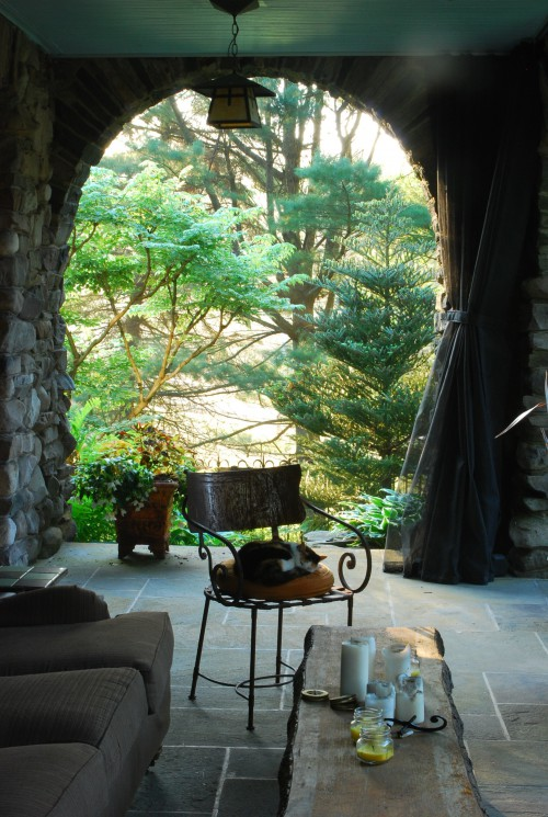 Stone Arches derive its name from the front porch of the house. Here the ambient temperature is cool and comfortable, encouraging summer evenings of socializing and relaxation. Each arch creates a different garden view.