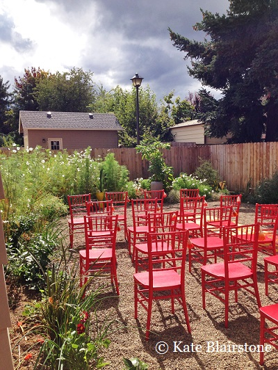 Bright colors always tickle Kate's aesthetic senses - her photograph of these red chairs against the green foliage of cosmos reflects that preference.